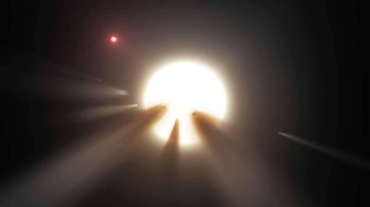 Caption: This artist's conception shows a star behind a shattered comet. One of the theories for KIC 8462852's unusual dimming is the presence of debris from a collision or breakup of a planet or comet in the star's system, creating a short-term cloud that blocks some starlight. Image is courtesy of NASA/JPL-Caltech.