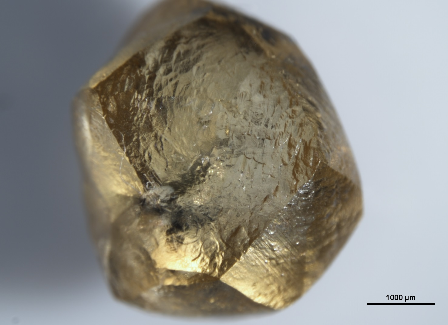 Images of diamonds from Sierra Leone with sulfur-containing mineral inclusions courtesy of the Gemological Institute of America