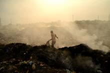 Land and air pollution in Amravati, India, purchased from Shutterstock.