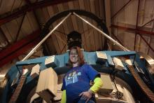 Johanna Teske in front of Magellan telescope.