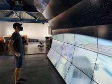 Carnegie theoretical astrophysicist Anthony Piro engages with the VizLab wall.