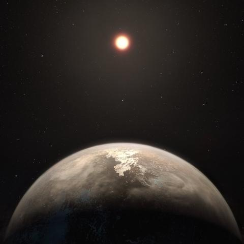 This artist's impression shows the temperate planet Ross 128 b, with its red dwarf parent star in the background. It is provided courtesy of ESO/M. Kornmesser.
