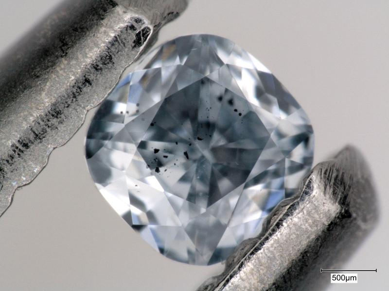 : A blue, boron-bearing diamond with dark inclusions of a mineral called ferropericlase, which were examined as part of this study.  This gem weighs 0.03 carats.  Photo by Evan Smith/GIA.