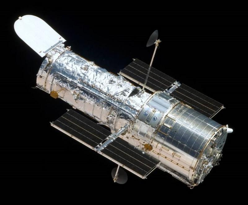 An image of the Hubble Space Telescope floating against the background of space courtesy of NASA.