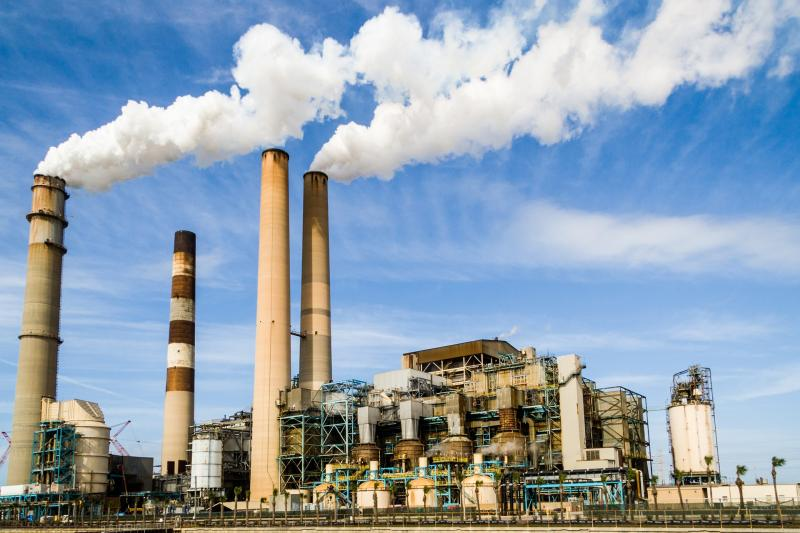 Public domain image of power plant with smokestacks